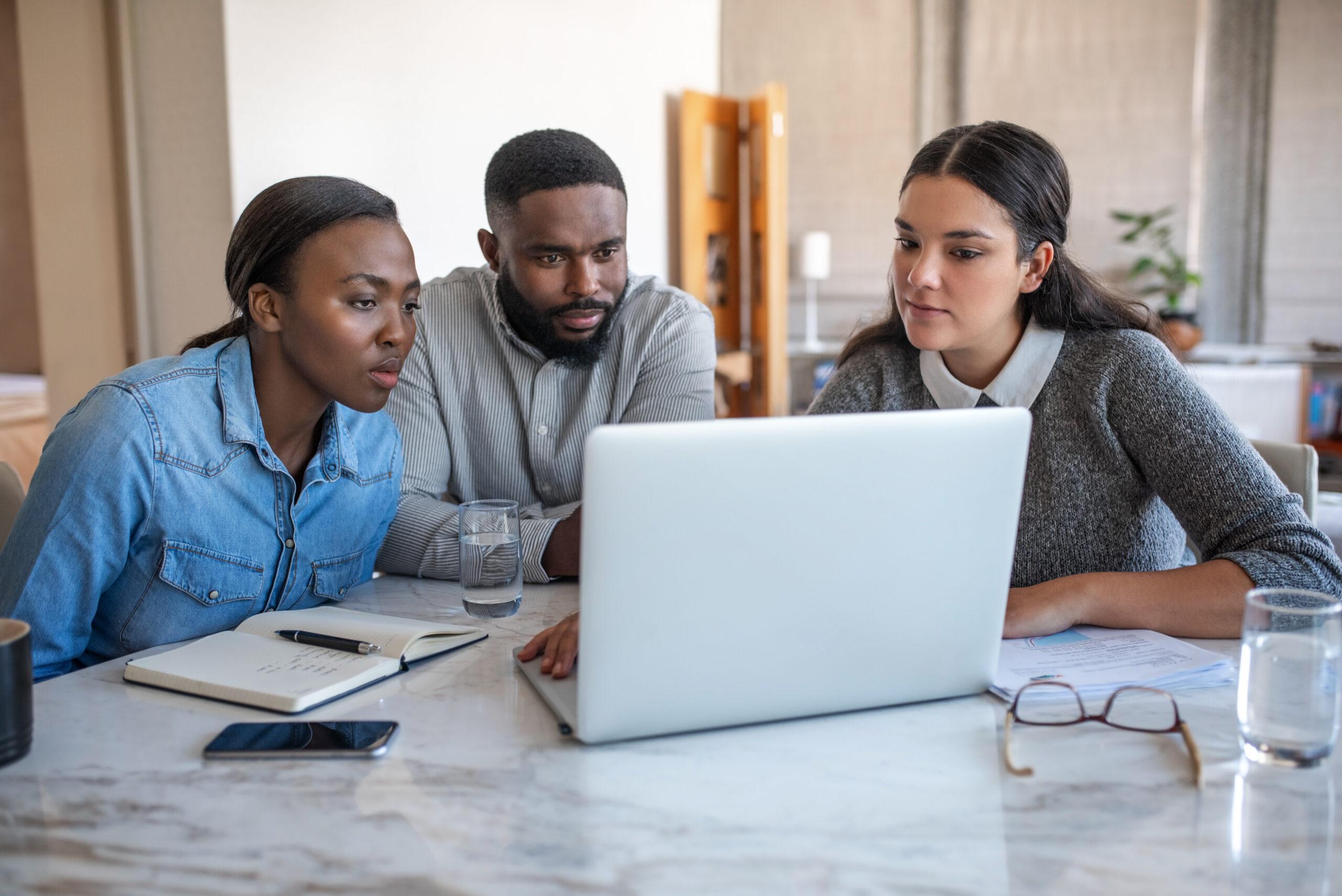 financial advisor wth client looking at facbook social media
